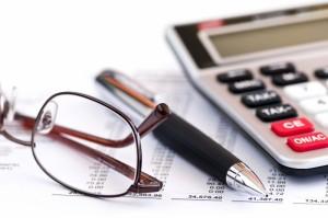 514398-tax-calculator-pen-and-glasses